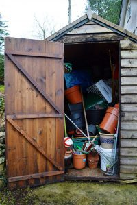 Messy garden shed with door open