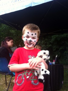 Child with face painted at event